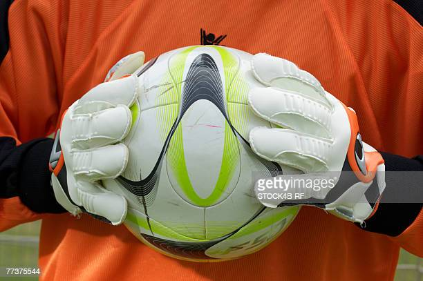 goalkeeper holding ball - sports jersey stock pictures, royalty-free photos & images