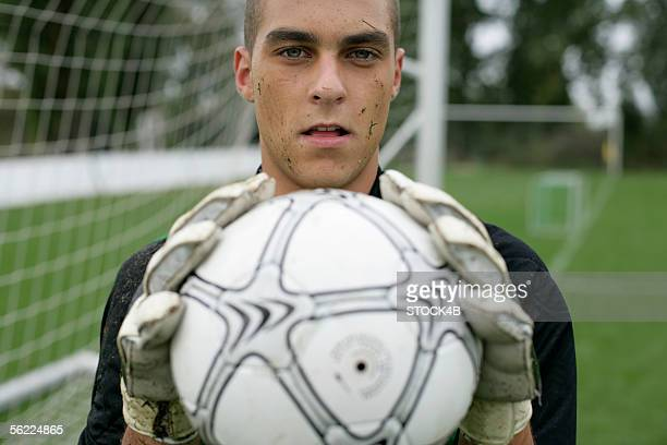 goalkeeper holding football in his hands - goalie goalkeeper football soccer keeper stock pictures, royalty-free photos & images