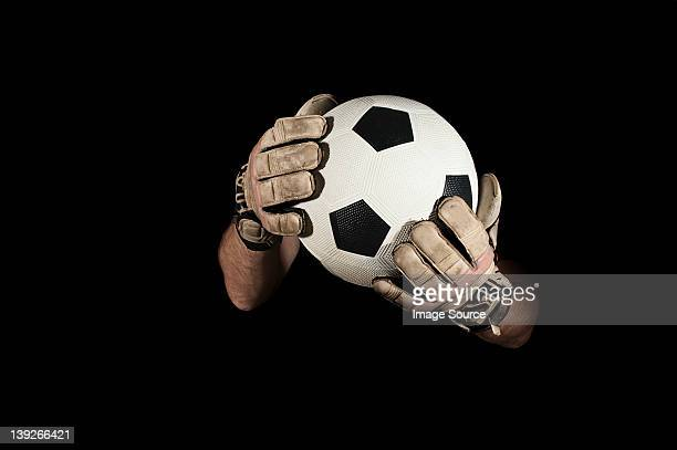 goalkeeper holding football - goalie goalkeeper football soccer keeper stock pictures, royalty-free photos & images