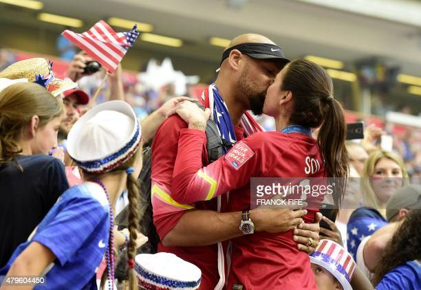 USA goalkeeper Hope Solo is kissed by husband Jerramy Stevens after winning the final football match between USA and Japan during their 2015 FIFA...