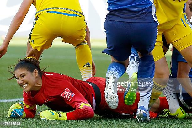 Goalkeeper Hope Solo of the United States reacts after making a save in goal in the first half against Sweden in the FIFA Women's World Cup Canada...