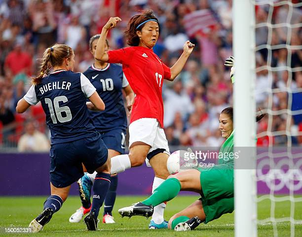 Goalkeeper Hope Solo of United States makes a save on a shot by Yuki Ogimi of Japan in the first half during the Women's Football gold medal match on...