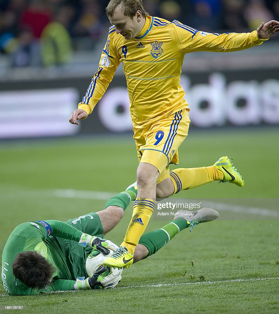 Goalkeeper Hugo Lloris (L) of France fights for the ball with Ukraine's Oleh Gusiev (R) during the FIFA 2014 World Cup Qualifier Play-off First Leg soccer match between Ukraine and France at the Olympic Stadium on November 15, 2013 in Kiev, Ukraine.