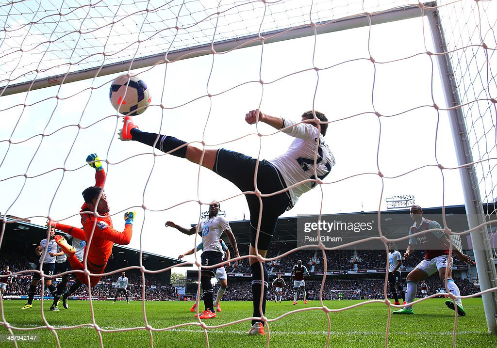 Goalkeeper Hugo Lloris of Spurs and Gylfi Sigurdsson of Spurs fail to stop the ball going into the net as teamateHarry Kane of Spurs scores an own goal during the Barclays Premier League match between West Ham United and Tottenham Hotspur at Boleyn Ground on May 3, 2014 in London, England.