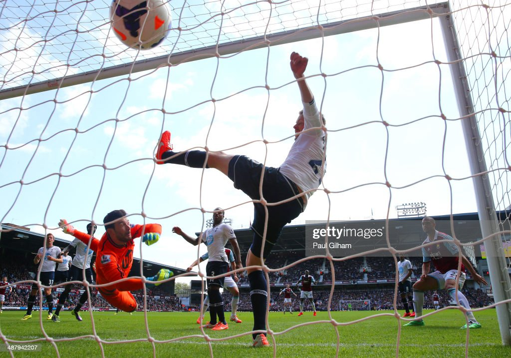 Goalkeeper Hugo Lloris of Spurs and Gylfi Sigurdsson of Spurs fail to stop the ball going into the net as teamate Harry Kane (L) of Spurs scores an own goal during the Barclays Premier League match between West Ham United and Tottenham Hotspur at Boleyn Ground on May 3, 2014 in London, England.