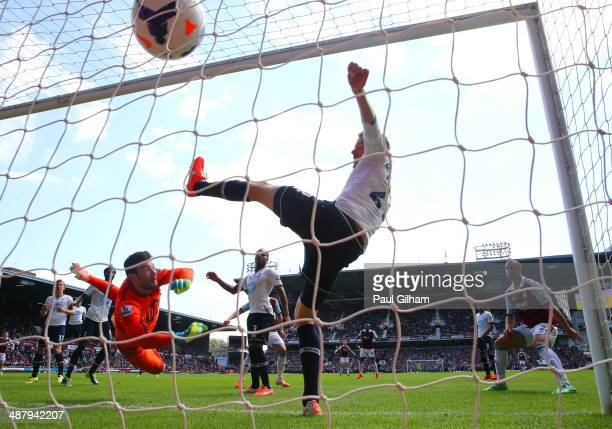 Goalkeeper Hugo Lloris of Spurs and Gylfi Sigurdsson of Spurs fail to stop the ball going into the net as teamate Harry Kane of Spurs scores an own...