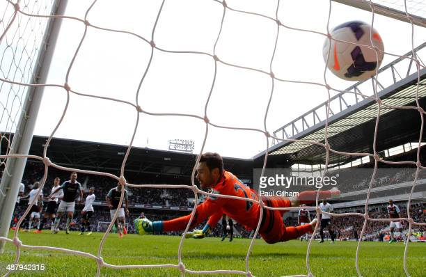 Goalkeeper Hugo Lloris of Spurs dves in vain as Stewart Downing of West Ham scores his team's second goal during the Barclays Premier League match...
