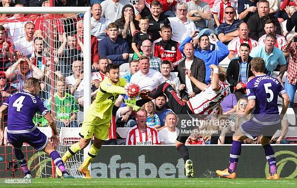 Goalkeeper Hugo Lloris of Tottenham Hotspur foils Ola Toivonen of Sunderland during the Barclays Premier League match between Sunderland and...