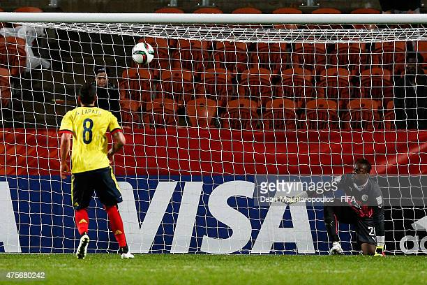 Goalkeeper Ibrahima Sy of Senegal can only watch as Alexis Zapata of Colombia takes and scores a penalty during the FIFA U20 World Cup New Zealand...
