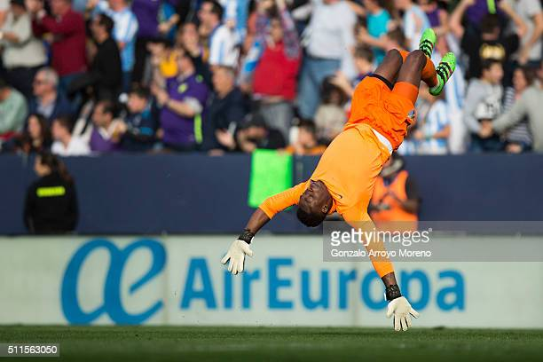 Goalkeeper Idriss Carlos Kameni of Malaga CF celebrates his team's first goal during the La Liga match between Malaga CF and Real Madrid CF at La...