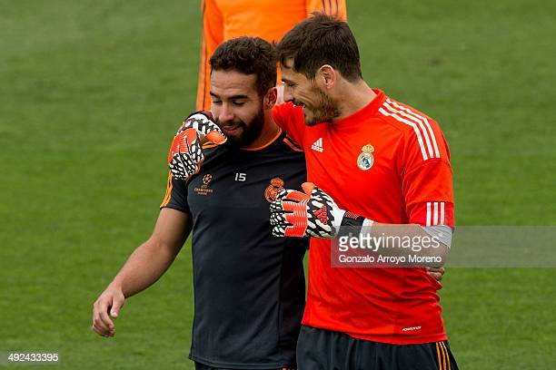 Goalkeeper Iker Casillas of Real Madrid CF holds his teammate Daniel Carvajal after the training session held on the Real Madrid media day prior to...