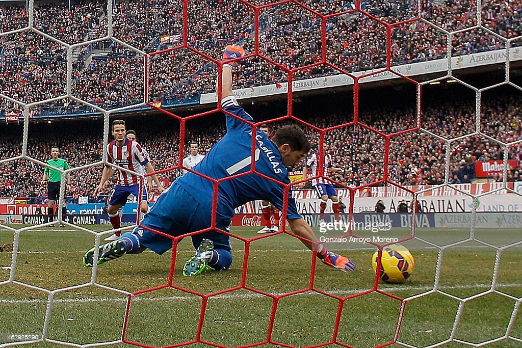 Goalkeeper Iker Casillas of Real Madrid CF misses a save as Tiago Mendes of Atletico de Madrid scores during the La Liga match between Club Atletico de Madrid and Real Madrid CF at Vicente Calderon Stadium on February 7, 2015 in Madrid, Spain.