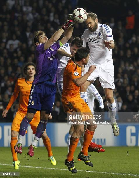 Goalkeeper Iker Casillas of Real Madrid makes a save against Olof Mellberg of FC Copenhagen during the UEFA Champions League Group B match between FC...