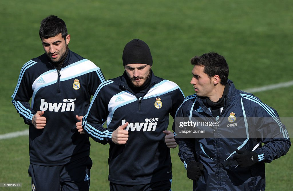 Goalkeeper Iker Casillas (C) of Real Madrid runs with two teammates during a training session the day after Real Madrid's UEFA Champions League aggregate defeat against Lyon at Valdebebas training ground on March 11, 2010 in Madrid, Spain.