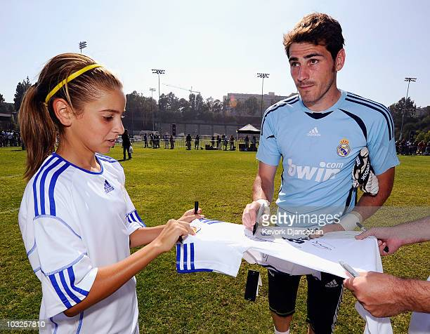 Goalkeeper Iker Casillas of Real Madrid signs a shirt for a local youth soccer player participating in the Adidas training August 5 2010 in Westwood...