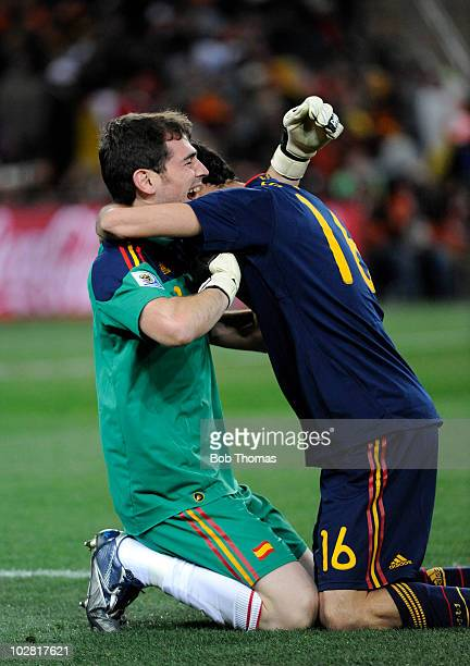 Goalkeeper Iker Casillas of Spain celebrates his teams goal with teammate Sergio Busquets during the 2010 FIFA World Cup Final between the...