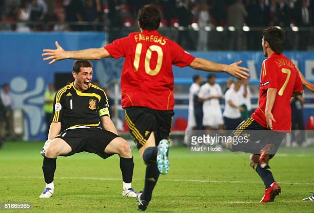 Goalkeeper Iker Casillas of Spain celebrates victory with team mates during the UEFA EURO 2008 Quarter Final match between Spain and Italy at Ernst...