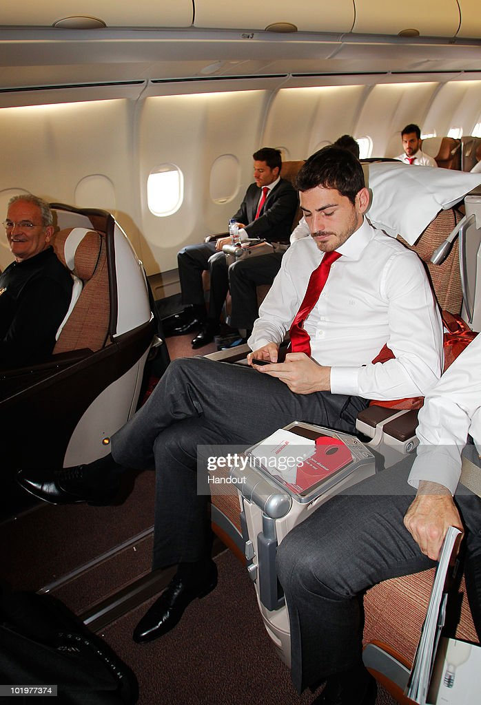 Goalkeeper Iker Casillas of Spain checks on his messages shortly after touch down at Johannesburg airport on June 11, 2010 in Johannesburg, South Africa.