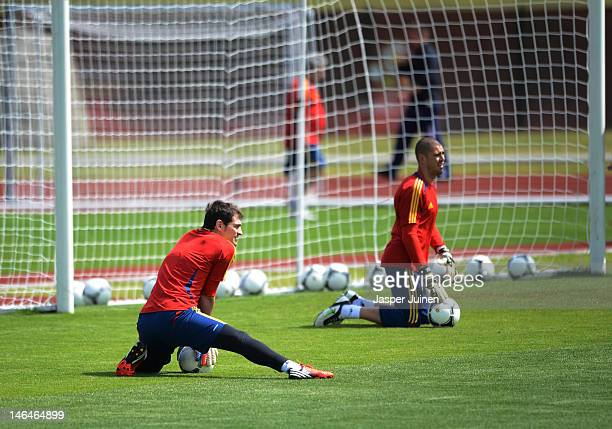 Goalkeeper Iker Casillas of Spain excercises with his teammate Victor Valdes during a training session ahead of their UEFA EURO 2012 group C match...