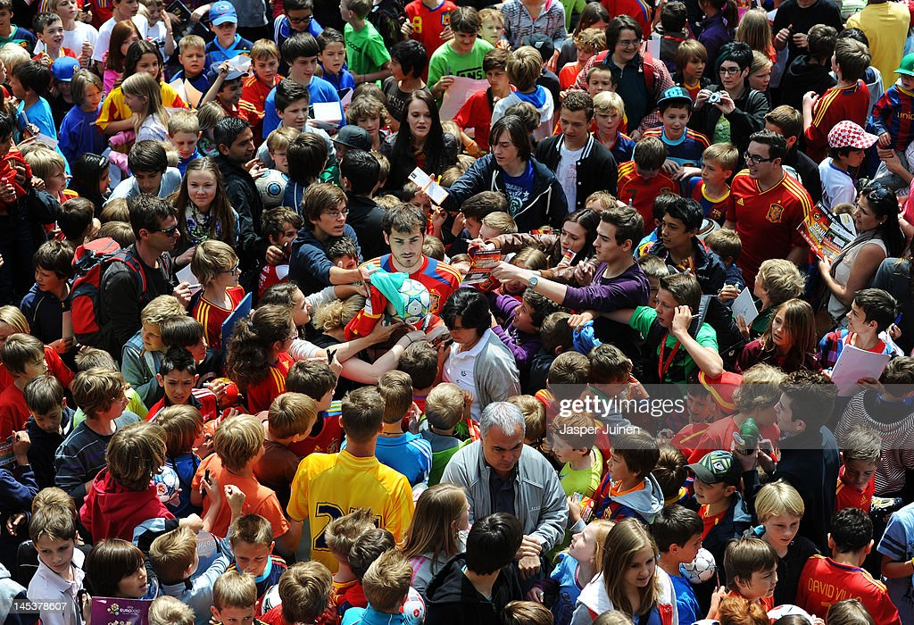 Goalkeeper Iker Casillas (C) of Spain is surrounded by fans after they invated the pitch at the end of a training session on May 28, 2012 in Schruns, Austria.
