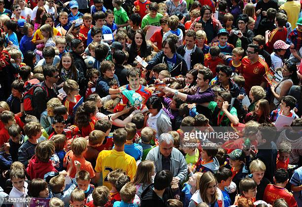 Goalkeeper Iker Casillas of Spain is surrounded by fans after they invated the pitch at the end of a training session on May 28, 2012 in Schruns,...