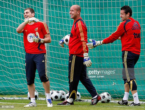 Goalkeeper Iker Casillas of Spain smiles flanked by the other two goalkeepers of the Spanish national team Pepe Reina and Andres Palop during a...