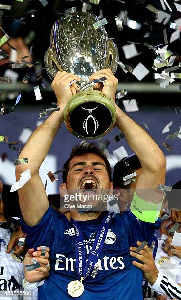 Goalkeeper Iker Casillas the captain of Real Madrid lifts the trophy following his team's 20 victory during the UEFA Super Cup between Real Madrid...