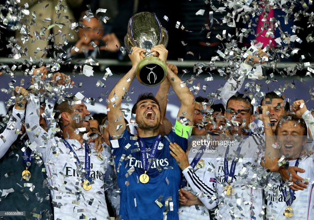 Goalkeeper Iker Casillas the captain of Real Madrid, lifts the trophy following his team's 2-0 victory during the UEFA Super Cup between Real Madrid and Sevilla FC at Cardiff City Stadium on August 12, 2014 in Cardiff, Wales.