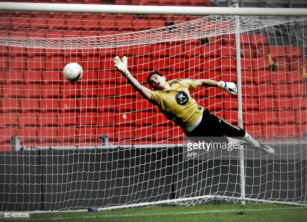 Goalkeeper Iker Casillas trains during a training session with the Spanish national soccer team players at the Parken Stadium in Copenhagen on August...