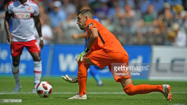 Goalkeeper Ioannis Gelios of Rostock throws the ball during the 3. Liga match between FC Energie Cottbus and F.C. Hansa Rostock at Stadion der...