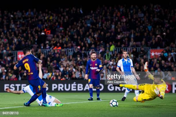 Goalkeeper Ivan Cuellar of CD Leganes saves a header from Luis Suarez of FC Barcelona during the La Liga match between Barcelona and Leganes at Camp...