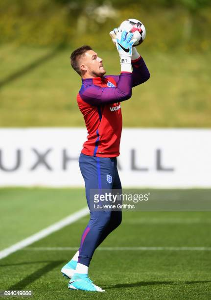 Goalkeeper Jack Butland of England catches the ball during an England training session on the eve of their FIFA World Cup qualifier against Scotland...