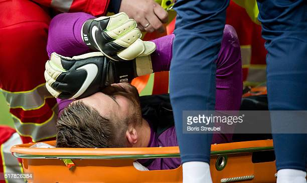 Goalkeeper Jack Butland of England is taken off the pitch by a stretcher after injury during the International Friendly match between Germany and...