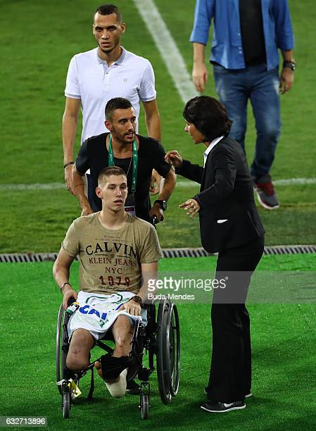 Goalkeeper Jackson Follmann Alan Ruschel and Neto who survived when the plane carrying Brazilian soccer team Chapecoense crashed enter to the field...