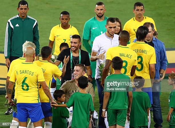 Goalkeeper Jackson Follmann Alan Ruschel and Neto who survived when the plane carrying Brazilian soccer team Chapecoense crashed are greeted by...