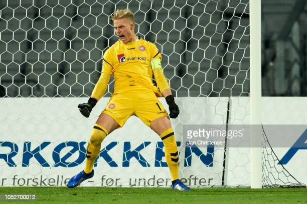 Goalkeeper Jacob Rinne of AaB Aalborg celebrate after a saved penalty kick during during the Danish Superliga match between AGF Arhus and AaB Aalborg...