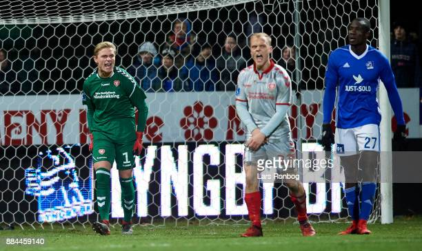Goalkeeper Jacob Rinne of AaB Aalborg gestures during the Danish Alka Superliga match between Lyngby BK and AaB Aalborg at Lyngby Stadion on December...