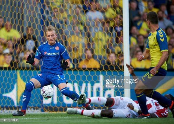 Goalkeeper Jacob Rinne of AaB Aalborg in action against Kamil Wilczek of Brondby IF during the Danish Alka Superliga match between Brondby IF and AaB...