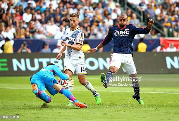 Goalkeeper Jaime Penedo of the Los Angeles Galaxy makes a save on a shot by Teal Bunbury of the New England Revolution in the second half during 2014...