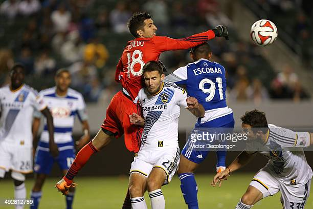 Goalkeeper Jaime Penedo of the Los Angeles Galaxy punches the ball for a save from Andres Escobar of FC Dallas as Tommy Meyer of the Los Angeles...