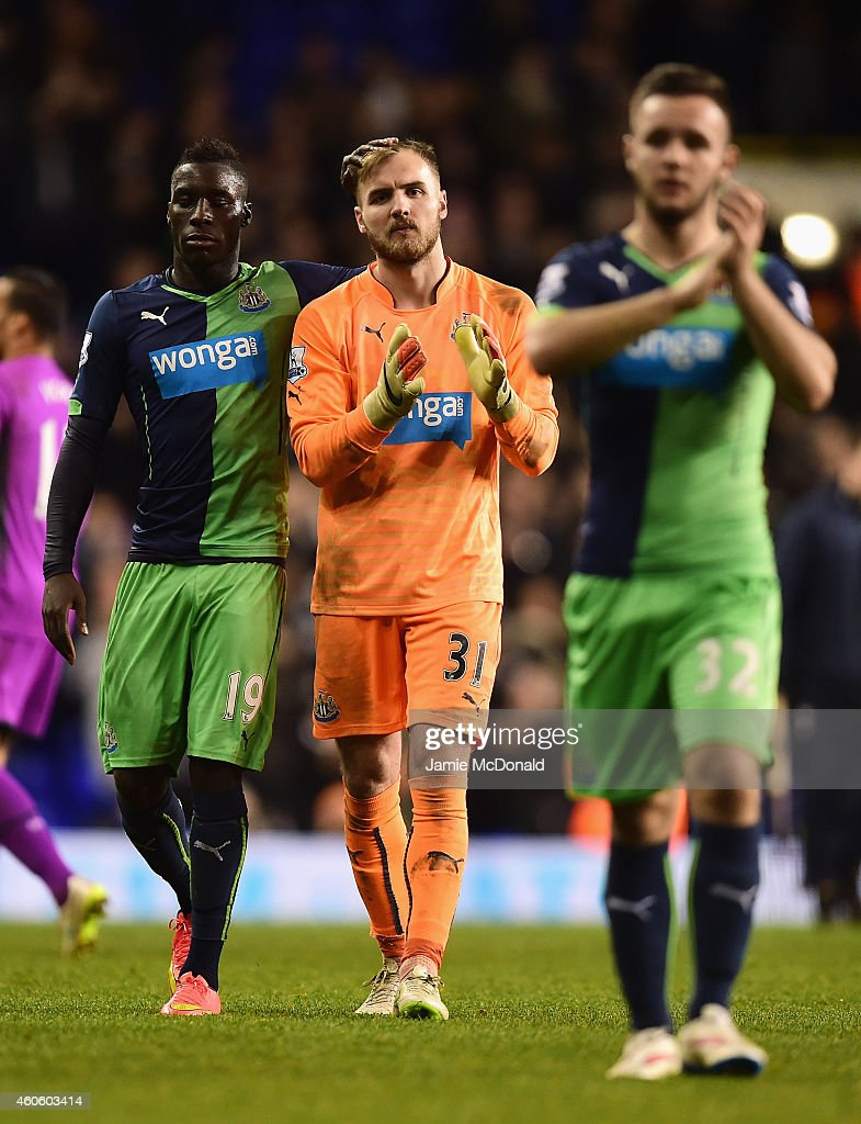 Goalkeeper Jak Alnwick of Newcastle United is consoled by Massadio Haidara of Newcastle United after the Capital One Cup Quarter-Final match between Tottenham Hotspur and Newcastle United at White Hart Lane on December 17, 2014 in London, England.