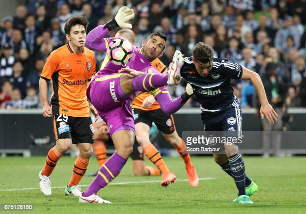 Goalkeeper Jamie Young of the Roar makes a save as Marco Rojas of the Victory competes for the ball during the ALeague Semi Final match between...