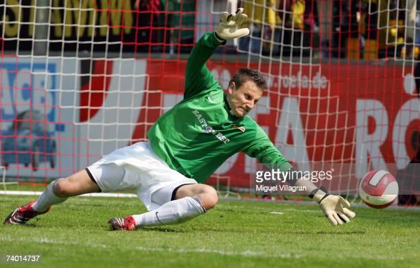 Goalkeeper Jan Glinker of Berlin saves the ball during the Third League match between 1.FC Union Berlin and Dynamo Dresden at the An der alten...