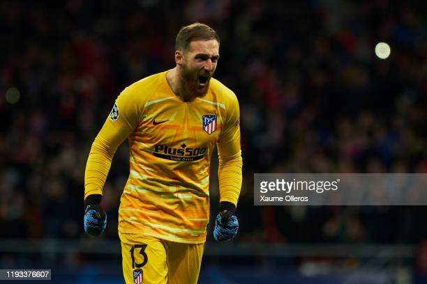 Goalkeeper Jan Oblak of Atletico de Madrid celebrates after his team's first goal scored by teammate Joao Felix during the UEFA Champions League...