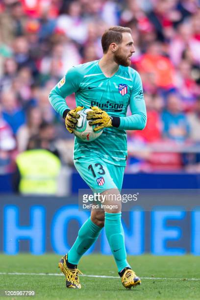 goalkeeper Jan Oblak of Atletico de Madrid controls the ball during the Liga match between Club Atletico de Madrid and Sevilla FC at Wanda...