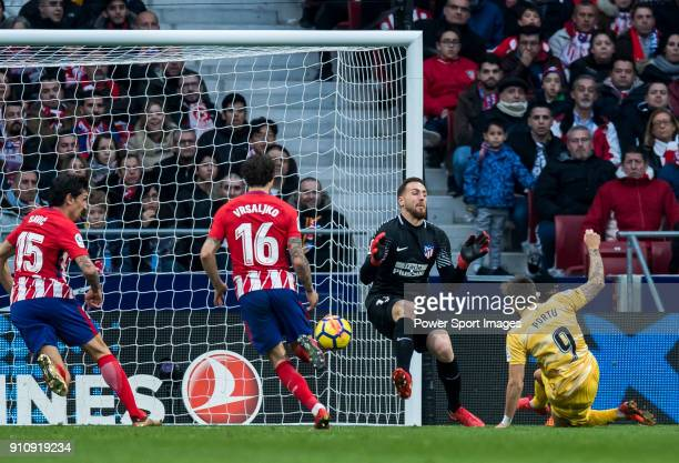 Goalkeeper Jan Oblak of Atletico de Madrid fails to save the ball shot by Cristian Portugues Manzanera Portu of Girona FC during the La Liga 201718...