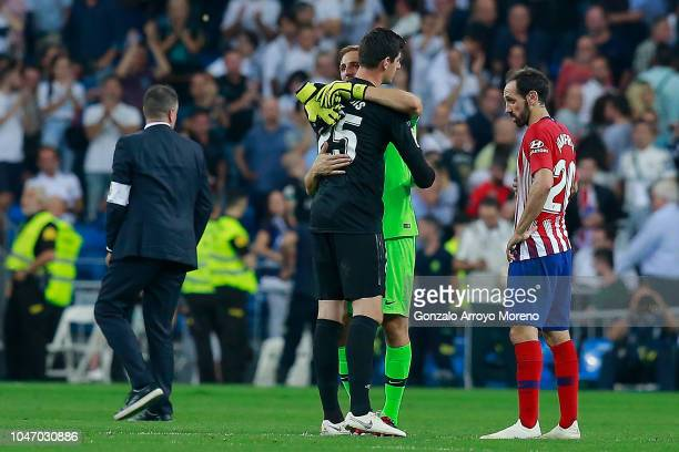 Goalkeeper Jan Oblak of Atletico de Madrid hugs goalkeeper Thibaut Courtois of Real Madrid CF after the La Liga match between Real Madrid CF and Club...