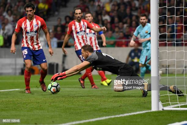 Goalkeeper Jan Oblak of Atletico de Madrid saves the ball during the La Liga 201718 match between Atletico de Madrid and FC Barcelona at Wanda...