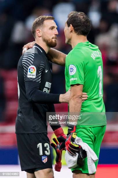 Goalkeeper Jan Oblak of Atletico de Madrid speaks to goalkeeper Gorka Iraizoz Moreno of Girona FC after the La Liga 201718 match between Atletico de...