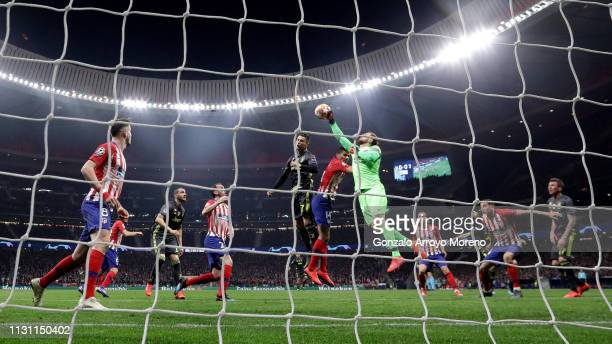 Goalkeeper Jan Oblak of Atletico de Madrid stops a header from Cristiano Ronaldo of Juventus during the UEFA Champions League Round of 16 First Leg...